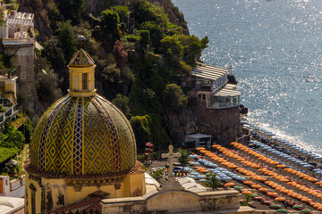 beach streets and colorful houses on the hill in Positano on Amalfi Coast in Italy