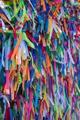 Foto op Canvas Paradijsvogel Colorful ribbons on the grid in front of Bonfim church in Salvador, Bahia, Brazil