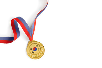 Gold medal on white background as a symbol of victory in sports competition in South Korea