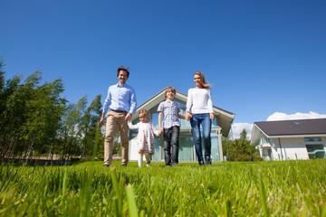 Family walking on lawn near house