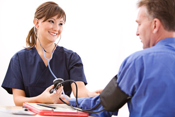 Doctors: Nurse Taking Blood Pressure