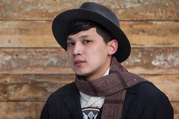 portrait of a beautiful Asian guy in a hat, Kazakh