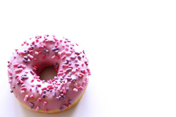 Donut with pink icing on a white background. Top view.