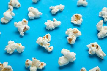 White popcorn on blue background. Flat lay pattern.