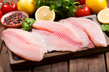 Wall Murals Fish fresh fish fillet with ingredients for cooking