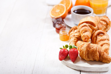 breakfast with croissants, coffee, juice and fresh fruits