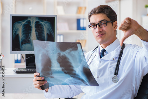Doctor Radiologist Looking At X Ray Images Stock Photo And Royalty