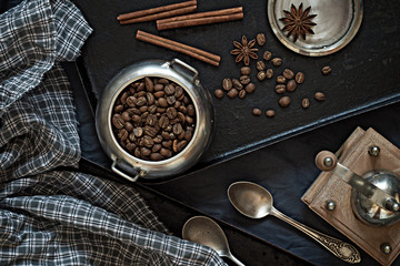 Coffee beans on a black baking sheet