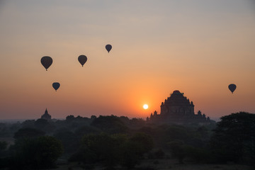 Beautiful landscape view sunrise of pagoda with balloons in Bagan city, Myanmar. A romantic great place for travel.