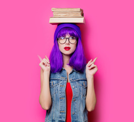 hipster girl with purple hair and books