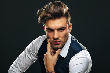 Papiers peints Salon de coiffure Portrait od handsome man in studio on dark background
