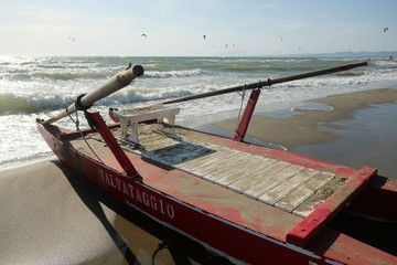 Italian paddle boat for the rescue (Italian: salvataggio) moored on the beach