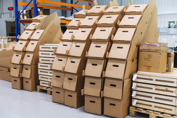 Many paper boxes against storehouse interior. Cardboard boxed in industry warehouse store. Logistic company. Delivery and distribution concept.