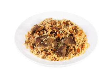 Aromatic pilaf on a plate with meat and spices