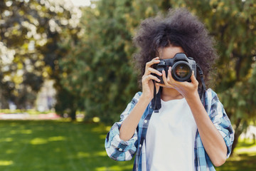 Young woman taking pictures outdoors