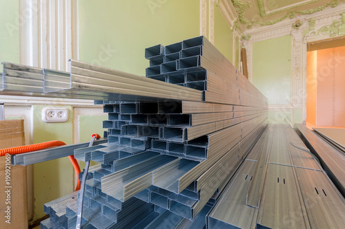 Frames for plasterboard (metal profiles for drywall) are being ...