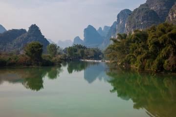 Aluminium Prints Reflection Beautiful landscape of karst mountains reflected in water, Yulong river in Yangshuo South China.