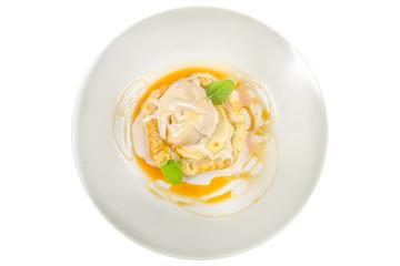 white round plate, banana cream, juicy ice cream, fresh herbs, corn flakes, crispy biscuits, cracker isolated on white background
