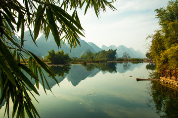 In de dag Reflectie Beautiful landscape of karst mountains reflected in water, Yulong river in Yangshuo South China.