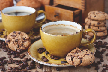 Composition with  coffee cup and tasty cookies