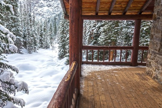 Alpine Teahouse Log Cabin and Snowy Forest Background on Plain of Six Glaciers above Lake Louise in Banff National Park Canadian Rockies