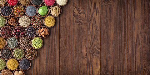Fototapete - large set of spices on a wooden table, top view