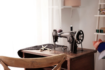 Tailor desk with old sewing machine