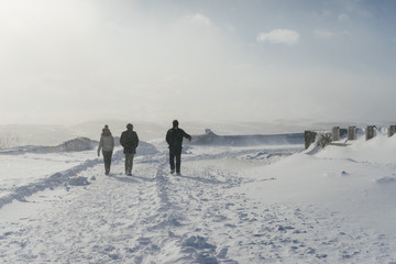 people against the background of a snow-covered field on a winter day