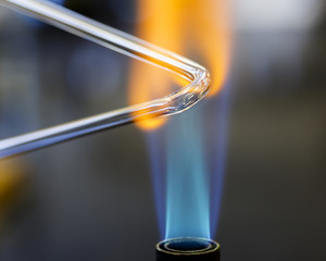 Glass bending in a bunsen burning flame in a chemistry lab