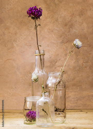 Dried flowers inside glass vase & Dried flowers inside glass vase\