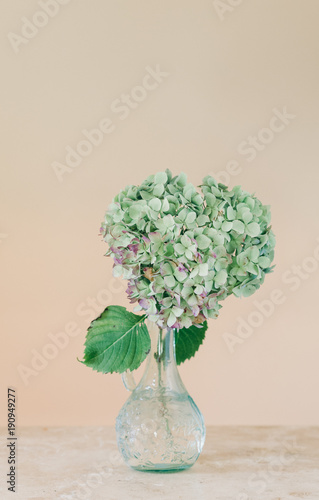 Hydrangea Flower Shaped Like A Heart In A Glass Vase On A Table