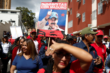 A placard depicting Venezuela's President Nicolas Maduro is seen during a rally to commemorate the 26th anniversary of late Venezuelan President Hugo Chavez failed coup attempt in Caracas