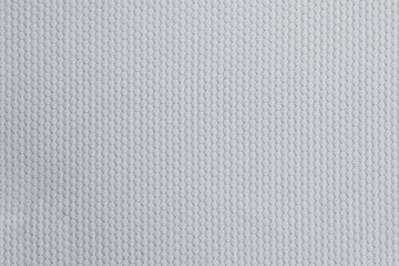 Texture of cool polyester fabric. Background of white textile Fototapete