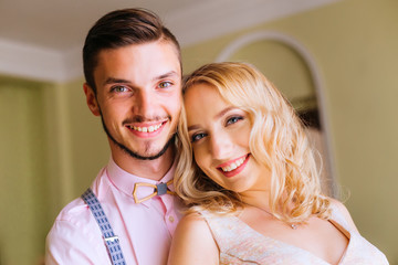 Close-up of a young couple who cute smile and and looking at the camera lens