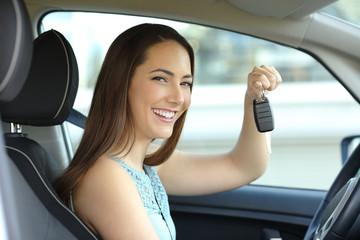Happy car owner holding keys looking at camera