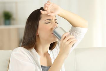Thirsty girl sugffering heatstroke and drinking soda