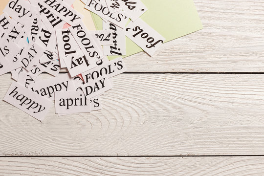 printed words Happy April Fools Day on wooden background