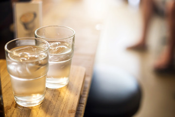 Water in a glass, selective focus