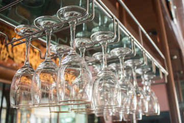 Glasses hanging above the bar in the restaurant.