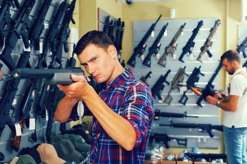 Men choosing air weapon