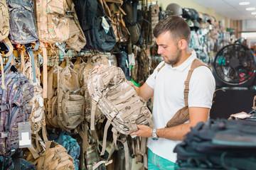 Male customer choise camouflage bag