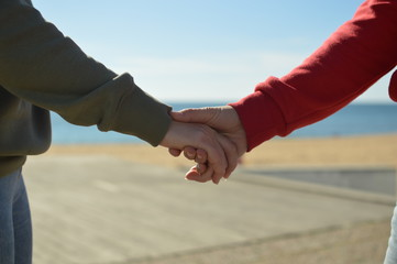 Touching human hands of cheerful people on sunshine beautiful nature outdoors. Lovely valentine harmony, symbolic friendship help. Closeup lifestyle support, dreams holiday freedom travel vacation