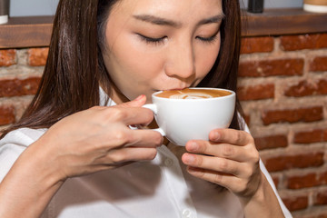 Woman drinking coffee at coffee shop