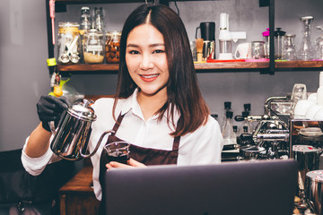 Barista holding coffee in coffee shop