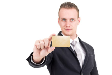Businessman holding a blank gold business card in his hand isolated on white background