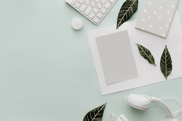 Modern Pastel Hipster Flat Lay With Headphones, keyboard and leaves