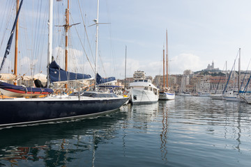 Old Port Sailboats and Houseboat in the calm water of the Mediterranean port in Marseilles, France.