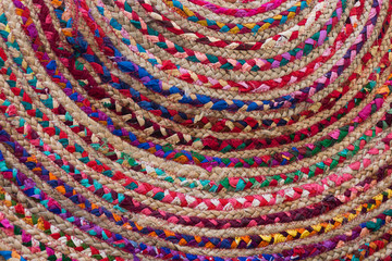 Rag Rug Close Up with colorful braided fabric sewn in a circle.