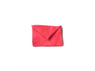 Red envelopes made from plasticine clay dough placed on white background