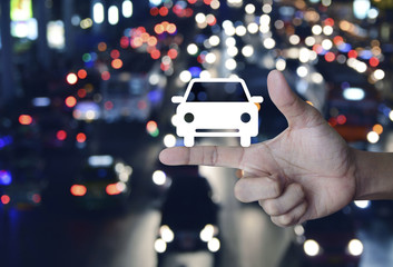 Taxi car flat icon on finger over blurred colourful night light city with cars, Business service car concept